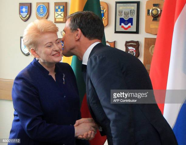 Lithuanian President Dalia Grybauskaite welcomes the Prime Minister of The Netherlands Mark Rutte as he arrives to visit soldiers serving in the NATO...