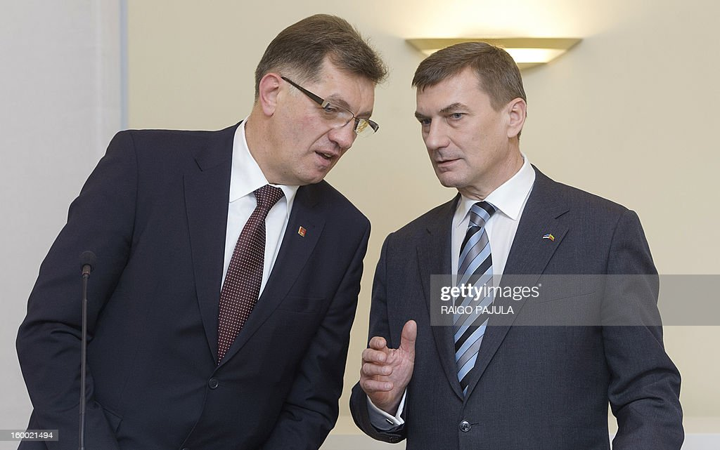 Lithuanian Prime Minister Algirdas Butkevicius (L) and Estonian counterpart Andrus Ansip speak during a joint press conference in Tallinn on January 24, 2013.