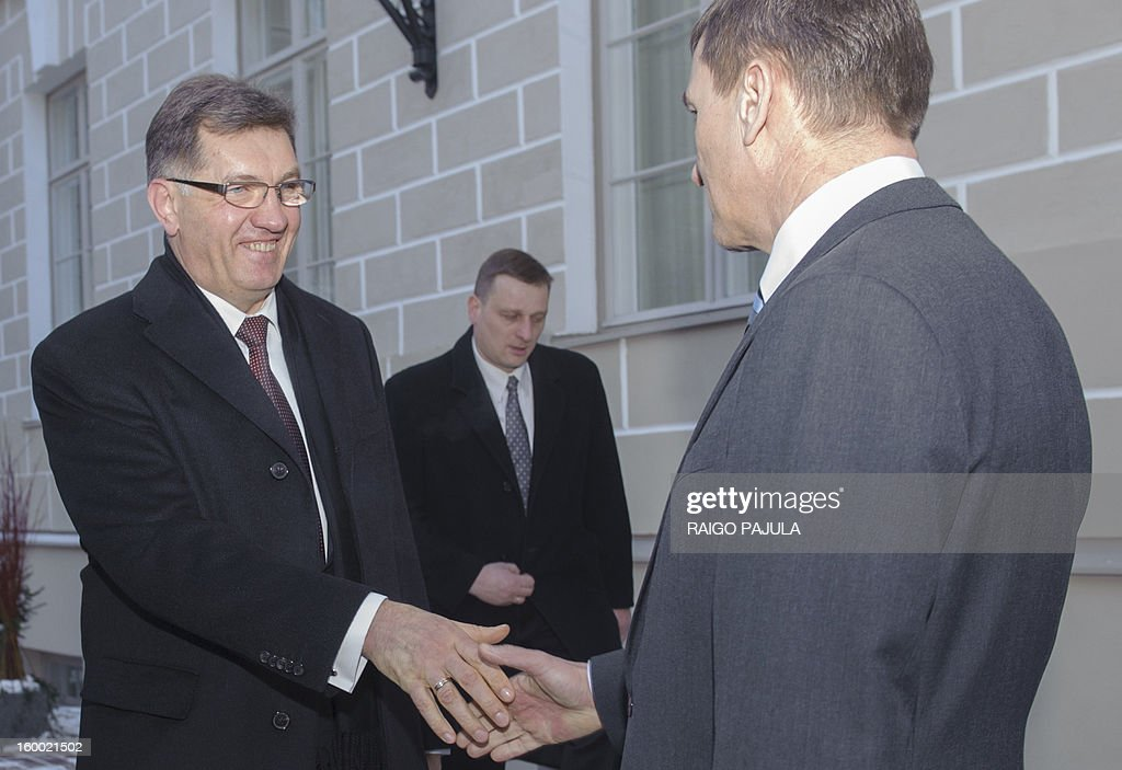 Lithuanian Prime Minister Algirdas Butkevicius (L) and Estonian counterpart Andrus Ansip shake hands after giving a joint press conference in Tallinn on January 24, 2013.