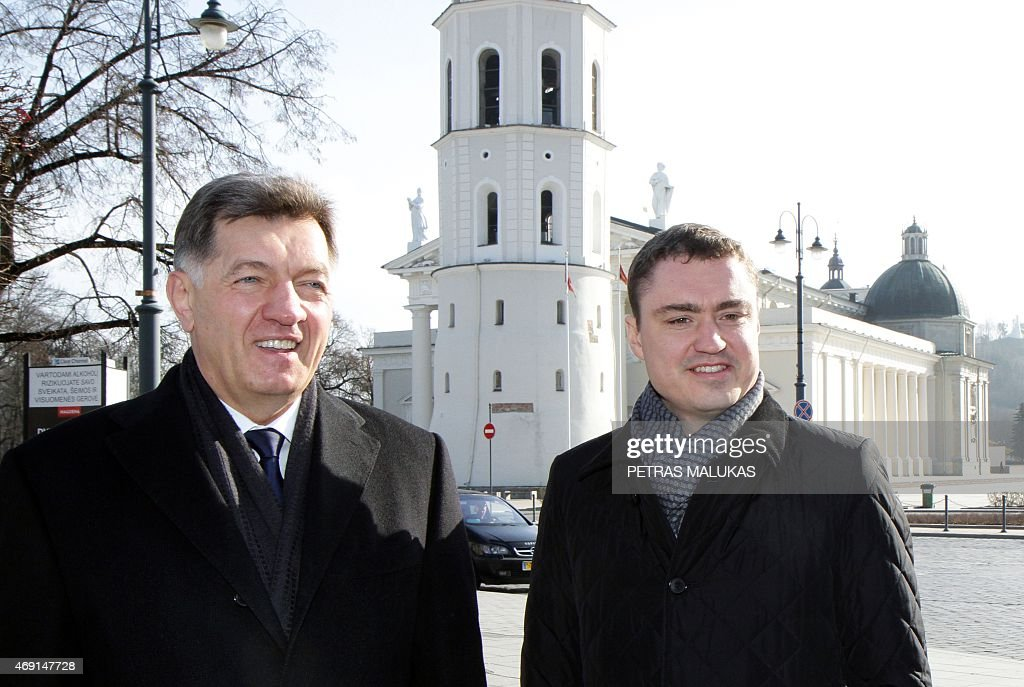 Lithuanian Prime Minister Algirdas Butkevicius (L) and Estonian Prime Minister Taavi Roivas arrive to attend the opening session of the Baltic Council of Ministers meeting in Vilnius on April 10, 2015.