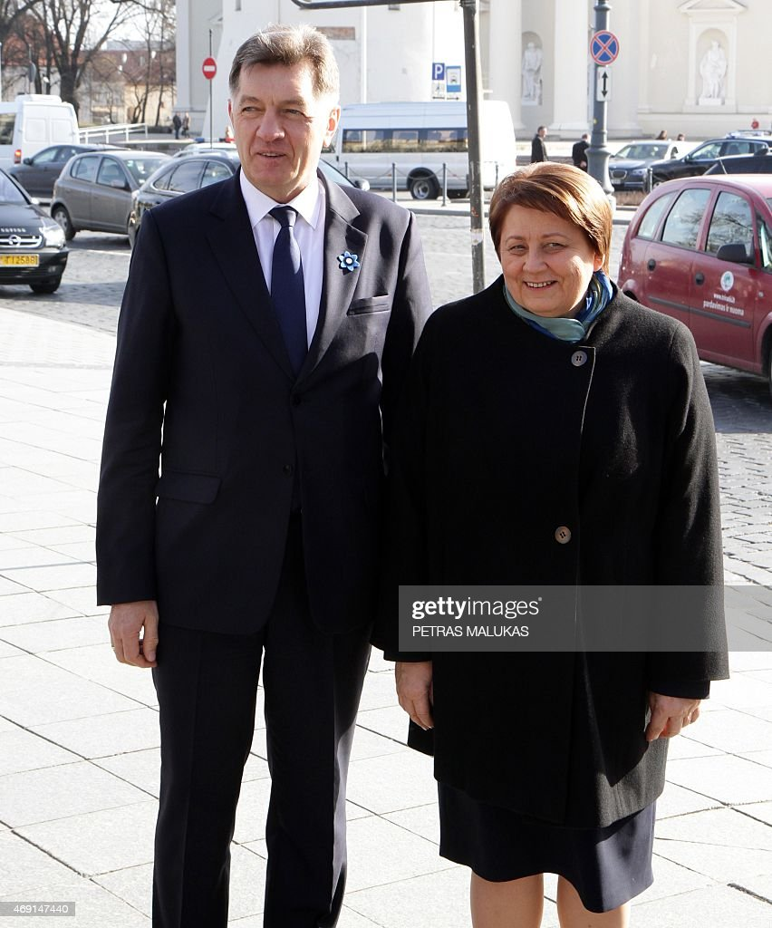 Lithuanian Prime Minister Algirdas Butkevicius (L) welcomes Latvia Prime Minister Laimdota Straujuma prior to the opening session of the Baltic Council of Ministers meeting in Vilnius on April 10, 2015.