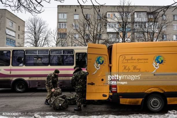 Lithuanian team loads aid in the truck most of the counters are exmilitary officers retired border guard and individual volunteers Lithuanian...