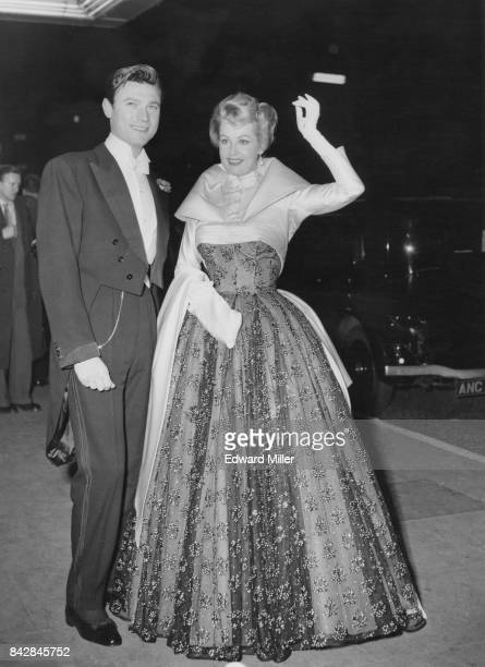 Lithuanianborn actor Laurence Harvey and actress Arlene Dahl arrive at the Empire Theatre in Leicester Square London for the Royal Film Performance...
