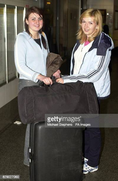 Lithuanian's Rimante Gailiunaite 22 and Greta kukauskiene 21 arrive at Victoria Coach Station on the day that the country joined the European Union...