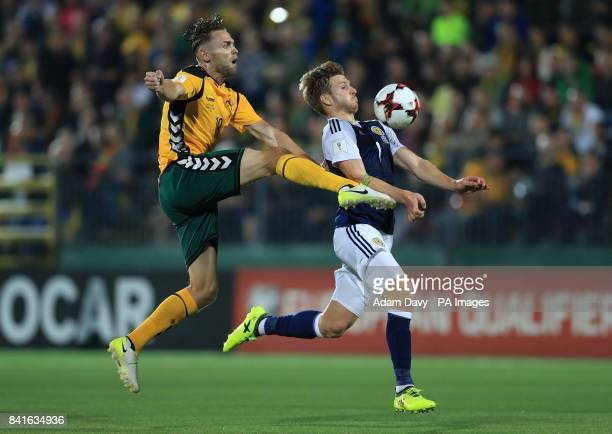 Lithuania's Arturas Zulpa and Scotland's Stuart Armstrong battle for the ball during the 2018 FIFA World Cup Qualifying Group F match at the LFF...