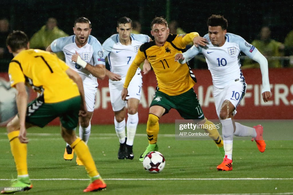 Lithuania's Arvydas Novikovas vies with England's midfielder Dele Alli (R) during the FIFA World Cup 2018 qualification football match between Lithuania and England in Vilnius on October 8, 2017. / AFP PHOTO / Petras Malukas