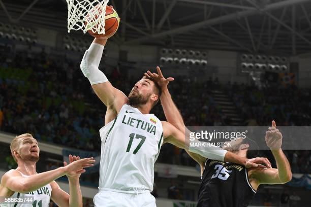 TOPSHOT Lithuania's centre Jonas Valanciunas holds off Argentina's centre Roberto Acuna during a Men's round Group B basketball match between...