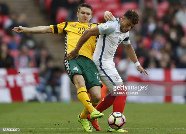Lithuania's defender Fiodor Cernych vies with England's midfielder Alex OxladeChamberlain during the World Cup 2018 qualification football match...