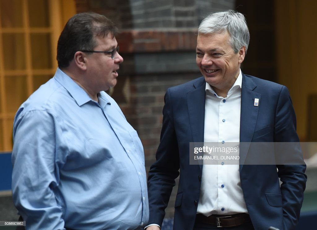 Finland's Foreign Minister Timo Soini (L) and Belgium's Foreign Minister Didier Reynders speak together ahead of a EU foreign ministers meeting in Amsterdam, on February 6, 2016. The European Union on Wednesday finally reached agreement on how to finance a three-billion-euro ($3.3-billion) deal to aid Syrian refugees in Turkey, in exchange for Ankara's help in stemming the flow of migrants. / AFP / EMMANUEL DUNAND