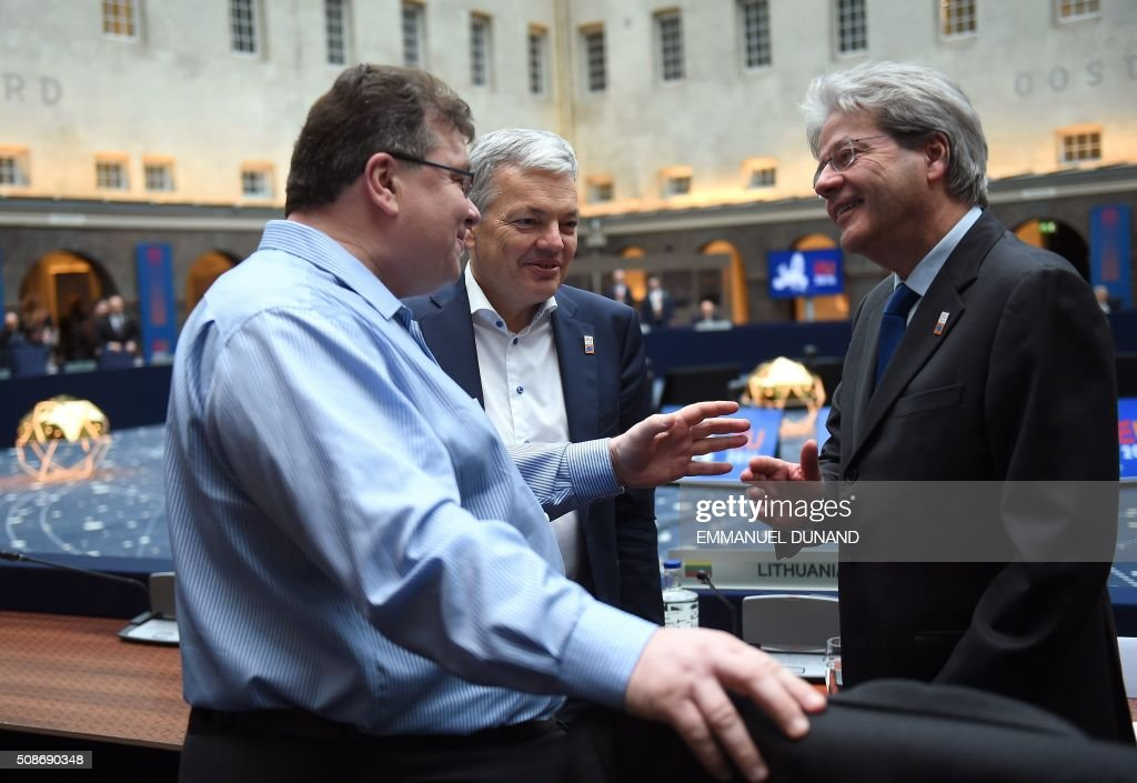 Finland's Foreign Minister Timo Soini, Belgium's Foreign Minister Didier Reynders and Italy's Foreign Minister Paolo Gentiloni speak together ahead of a EU foreign ministers meeting in Amsterdam, on February 6, 2016. The European Union on Wednesday finally reached agreement on how to finance a three-billion-euro ($3.3-billion) deal to aid Syrian refugees in Turkey, in exchange for Ankara's help in stemming the flow of migrants. / AFP / EMMANUEL DUNAND