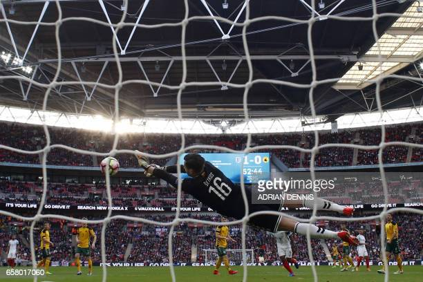 Lithuania's goalkeeper Ernestas Setkus makes a save from England's midfielder Alex OxladeChamberlain during the World Cup 2018 qualification football...