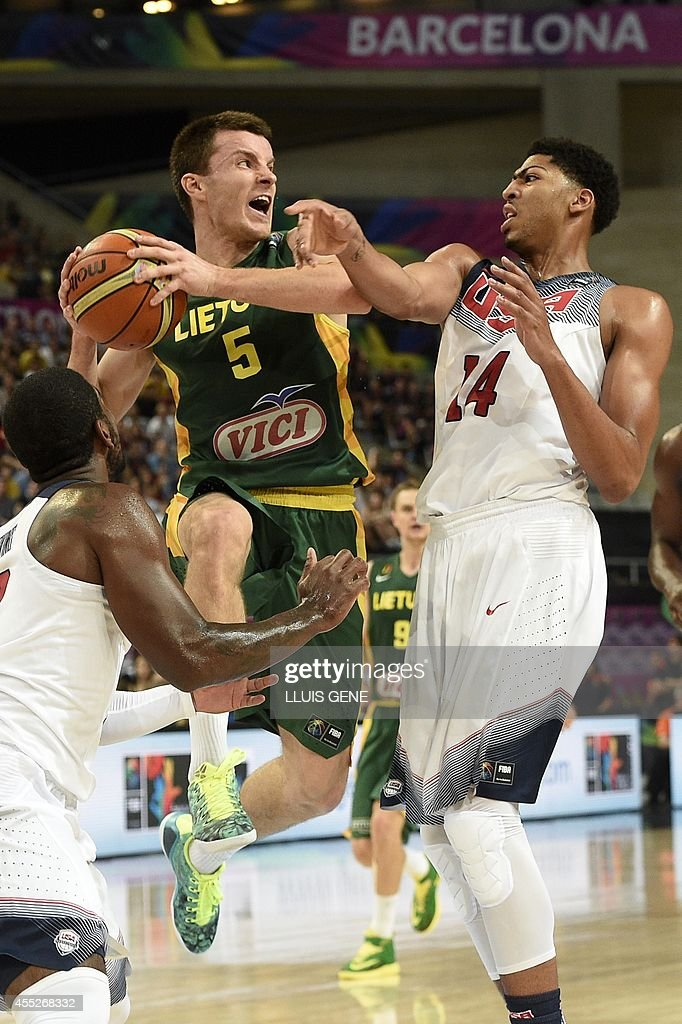 Lithuania's guard Adas Juskevicius vies with US centre Anthony Davis during the 2014 FIBA World basketball championships semifinal match Lithuania vs...