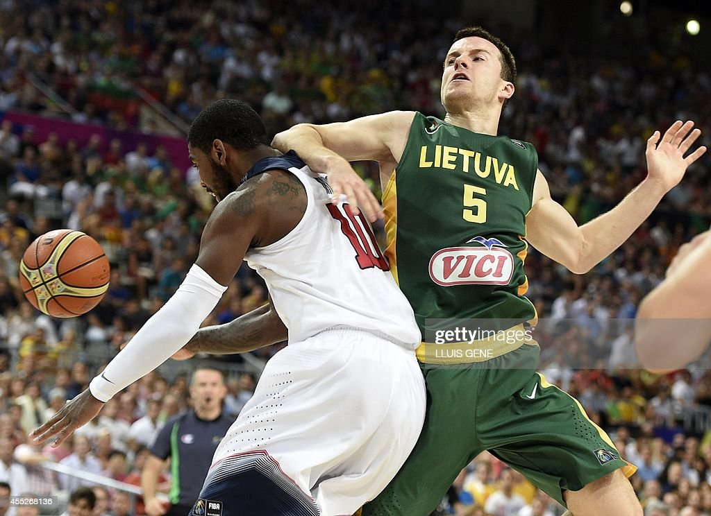 Lithuania's guard Adas Juskevicius (R) vies with US guard Kyrie Irving (L) during the 2014 FIBA World basketball championships semifinal match Lithuania vs USA at the Palau Sant Jordi in Barcelona on September 11, 2014.