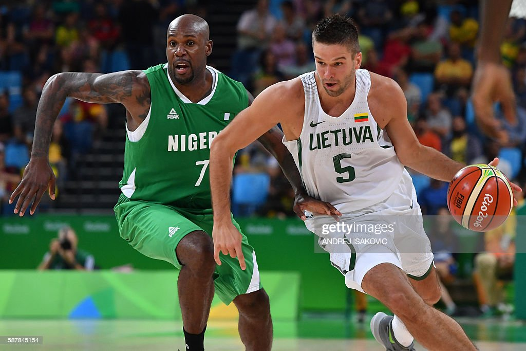 Lithuania's guard Mantas Kalnietis tries to pass Nigeria's small forward AlFarouq Aminu during a Men's round Group B basketball match between...