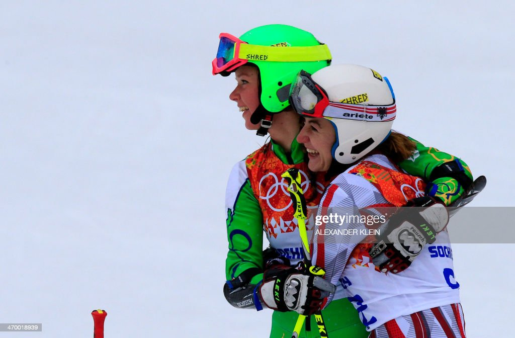 Lithuania's Ieva Januskeviciute and Uzbekistan's Kseniya Grigoreva react after the Women's Alpine Skiing Giant Slalom Run 1 at the Rosa Khutor Alpine Center during the Sochi Winter Olympics on February 18, 2014.