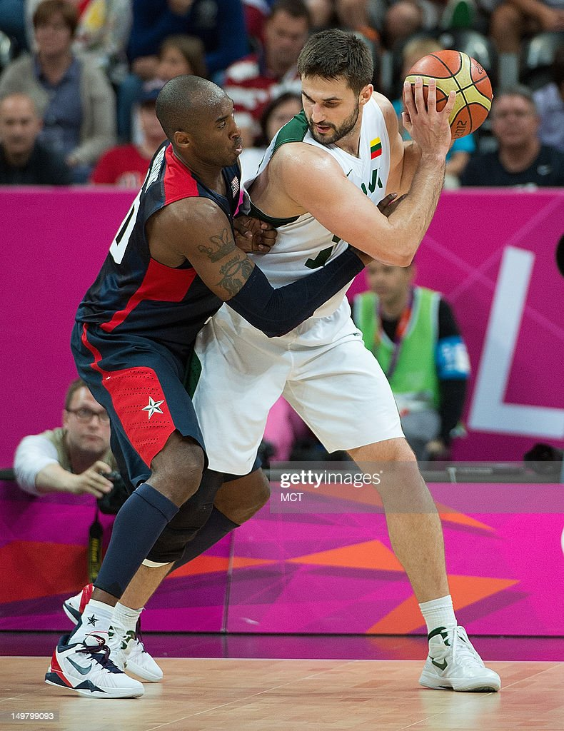 Lithuania's Linas Kleiza (11) is guarded closely by USA's Kobe Bryant (10) during their game at the Olympic Park Basketball Arena during the 2012 Summer Olympic Games in London, England, Saturday, August 4, 2012. USA defeated Lithuania 99-94.