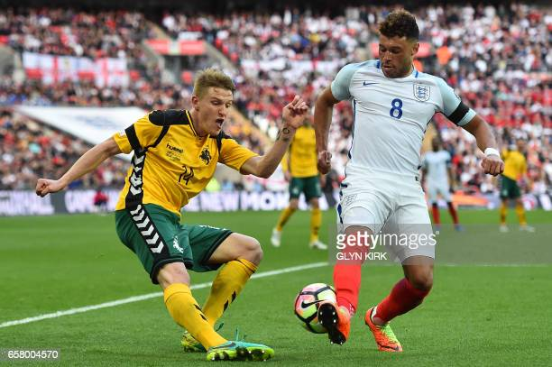 Lithuania's midfielder Vykintas Slivka vies with England's midfielder Alex OxladeChamberlain during the World Cup 2018 qualification football match...