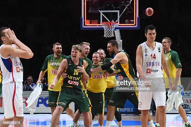 Lithuania's players celebrate after Lithuania defeated Serbia in their semifinal basketball match at the EuroBasket 2015 in Lille northern France on...
