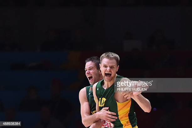 Lithuania's point guard Mantas Kalnietis and Lithuania's guard Renaldas Seibutis celebrate after Lithuania defeated Serbia in their semifinal...