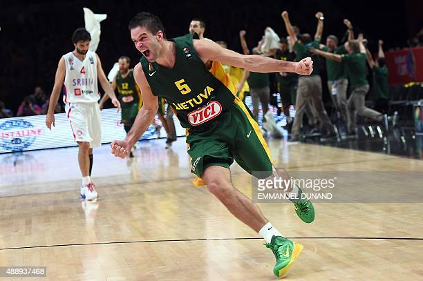 Lithuania's point guard Mantas Kalnietis celebrates after Lithuania defeated Serbia in their semifinal basketball match at the EuroBasket 2015 in...