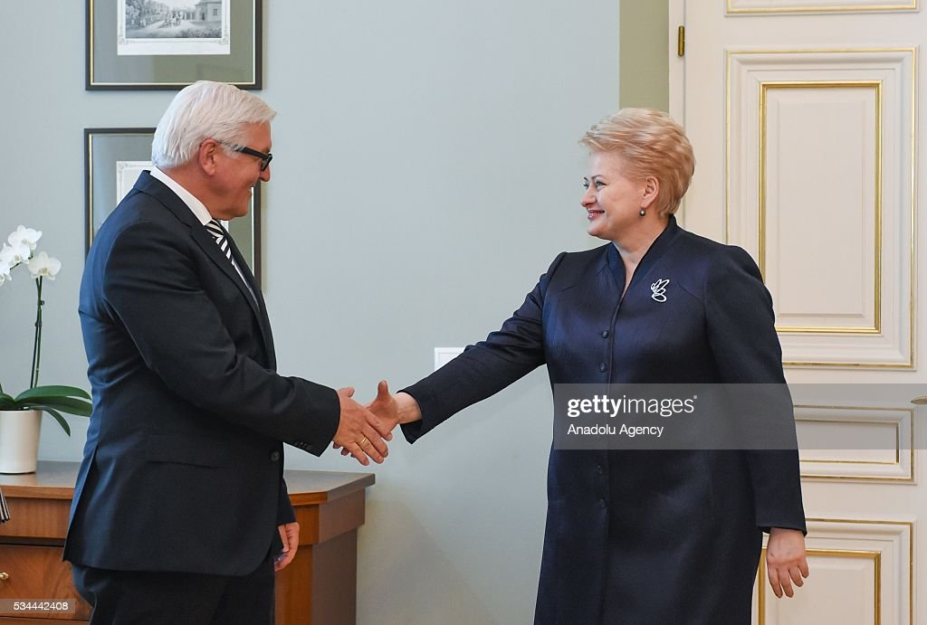 Lithuanias President Dalia Grybauskaite (R) and German Foreign Minister Frank-Walter Steinmeier (L) shake hands prior to their meeting in Vilnius, Lithuania on May 26, 2016.