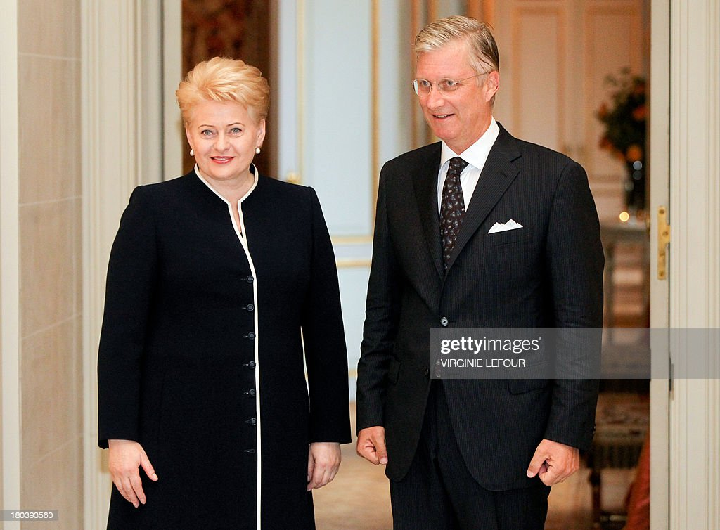 Lithuania's President Dalia Grybauskaite (L) and King Philippe of Belgium pose together as they attend a concert in honor of the Lithuanian presidency of the Council of the European Union at the Palace of Fine Arts in Brussels, on September 12, 2013.