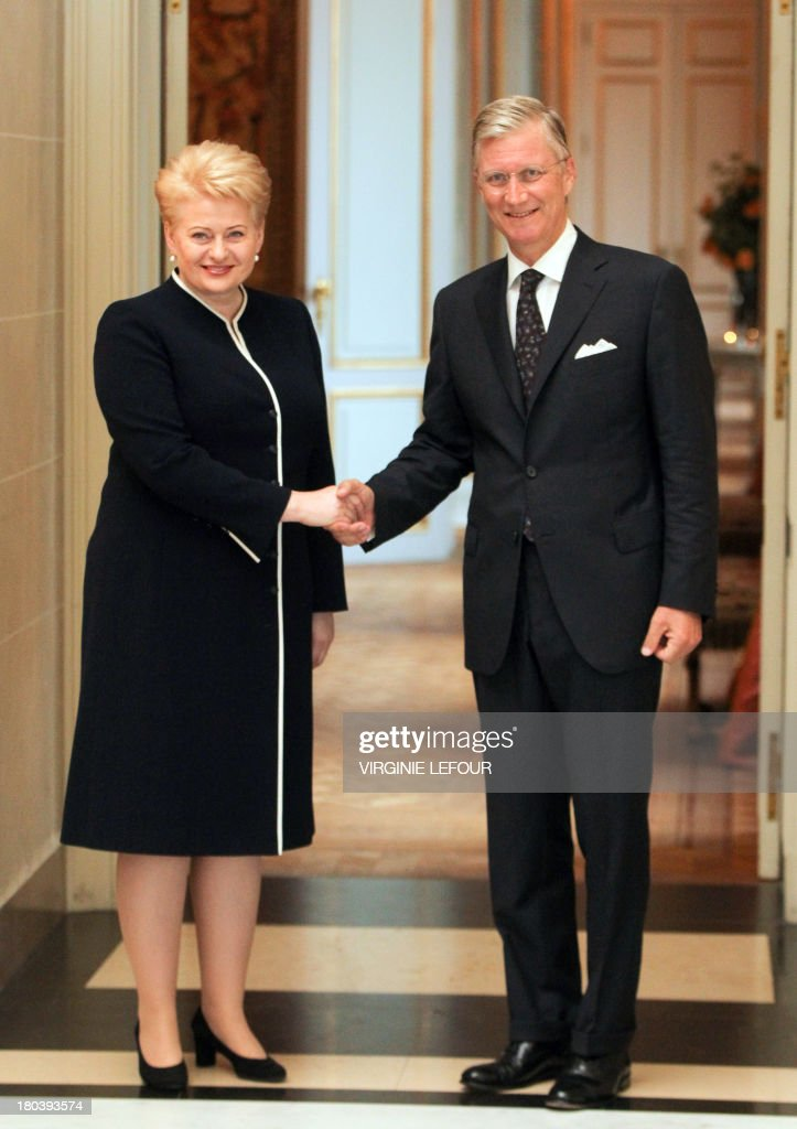 Lithuania's President Dalia Grybauskaite (L) and King Philippe of Belgium shake hands as they attend a concert in honor of the Lithuanian presidency of the Council of the European Union at the Palace of Fine Arts in Brussels, on September 12, 2013. AFP PHOTO / BELGA / VIRGINIE LEFOUR