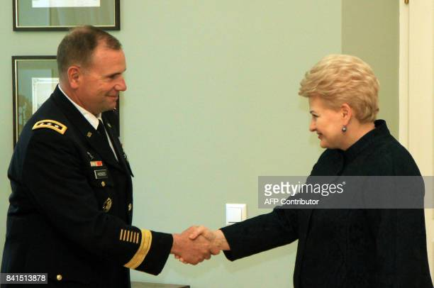 Lithuanias President Dalia Grybauskaite shakes hands with US Army Europe Commander Ben Hodges as they meet in Vilnus Lithuania on September 1 2017 /...