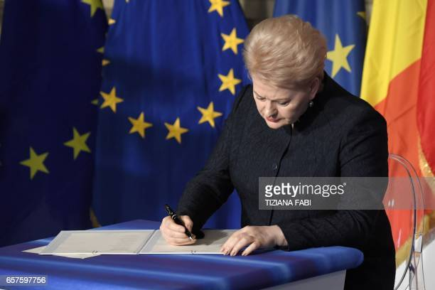 Lithuania's President Dalia Grybauskaite signs the new Rome declaration with leaders of 27 European Union countries special during a summit of EU...