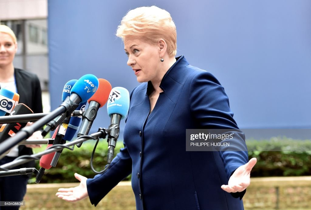 Lithuania's President Dalia Grybauskaite talks to the press as she arrives before an EU summit meeting on June 28, 2016 at the European Union headquarters in Brussels. / AFP / PHILIPPE