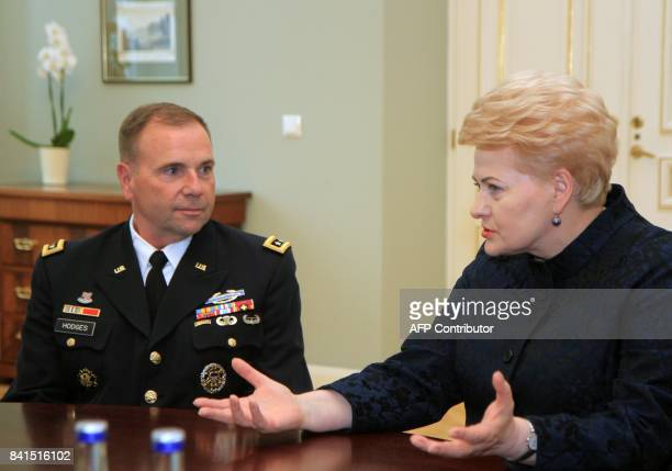 Lithuanias President Dalia Grybauskaite talks with US Army Europe Commander Ben Hodges as they meet in Vilnus Lithuania on September 1 2017 / AFP...