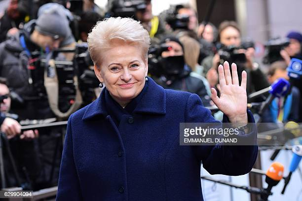 Lithuania's President Dalia Grybauskaite waves as she arrives for a European Union leaders summit focused on Russia sanctions and migration at the...
