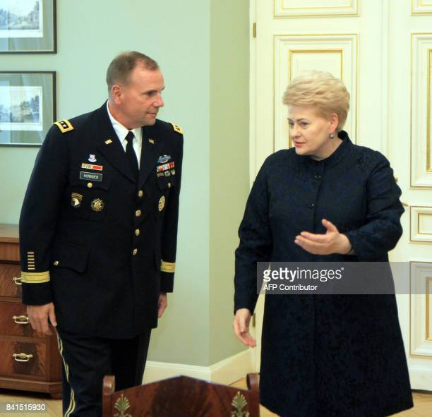 Lithuanias President Dalia Grybauskaite welcomes US Army Europe Commander Ben Hodges as they meet in Vilnus Lithuania on September 1 2017 / AFP PHOTO...