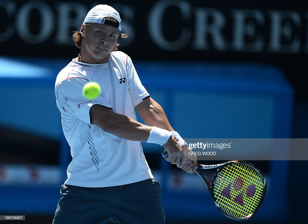 Lithuania's Ricardas Berankis hits a return against Britain's Andy Murray during their men's singles match on day six of the Australian Open tennis tournament in Melbourne on January 19, 2013.