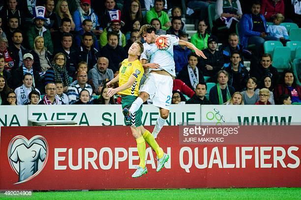 Lithuania's Vykintas Slivka vies with Slovenia's Rene Krhin during the Euro 2016 Group E qualifying football match between Slovenia and Lithuania at...