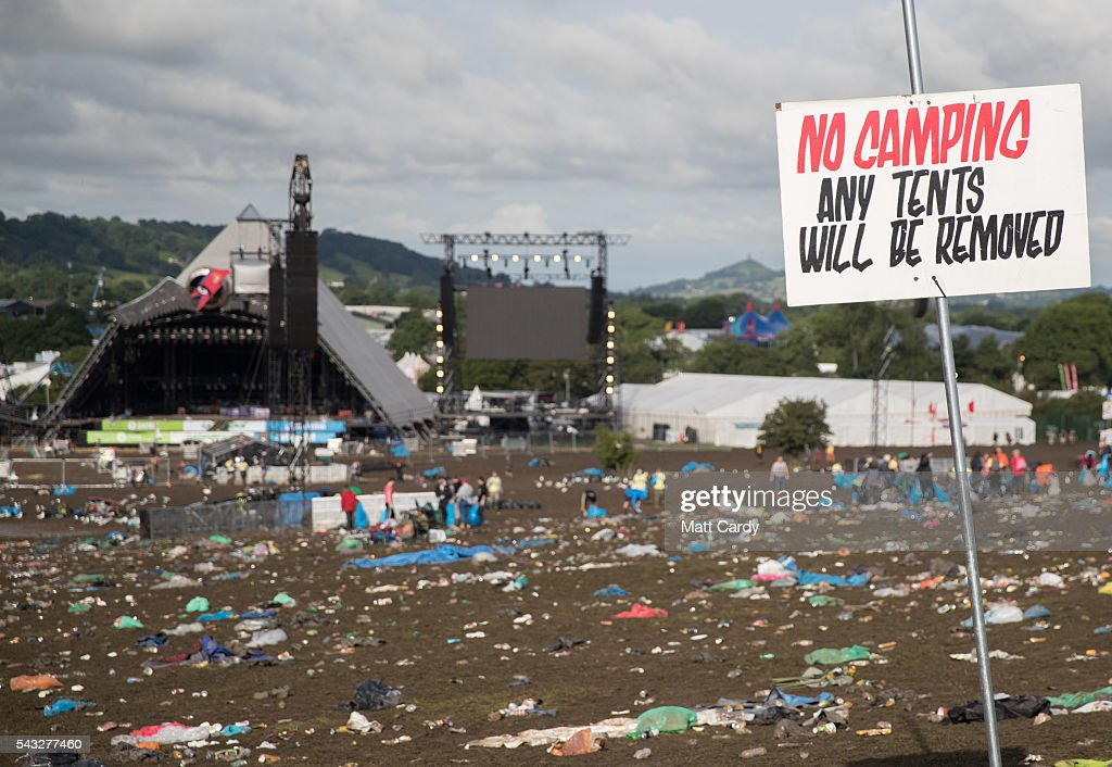 Litter pickers begin the job of clearing the fields in front of the main Pyramid Stage at the Glastonbury Festival 2016 at Worthy Farm, Pilton on June 26, 2016 near Glastonbury, England. The Festival, which Michael Eavis started in 1970 when several hundred hippies paid just £1, now attracts more than 175,000 people.