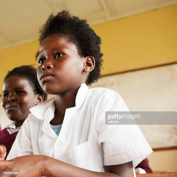 Little African girl sitting in Classroom