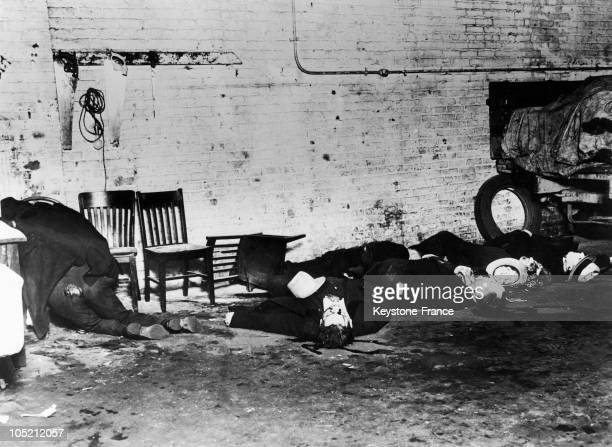 Little After The Massacre Of February 14 The Corpses Of Bug Moran'S Gangsters Lie On The Ground And On A Chair In A Garage In Chicago Killed By Al...