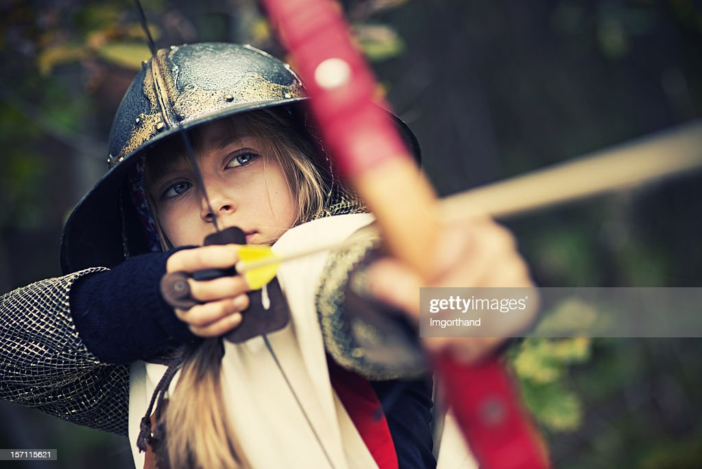 Little archer in woods : Stock Photo