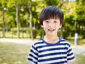outdoor portrait of a little asian boy.