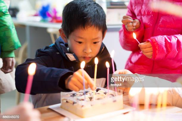 little asian boy with birthday cake