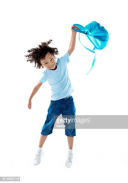 Little asian boy with schoolbag against white background