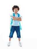 Little asian boy with schoolbag against white background.