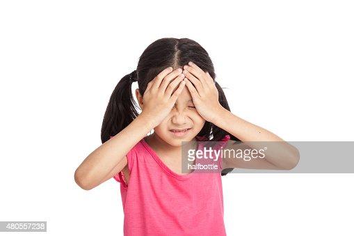 Little asian girl got sick and headache : Stock Photo