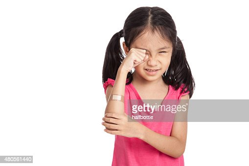 Little asian girl  hurt with bandage on her arm : Stock Photo