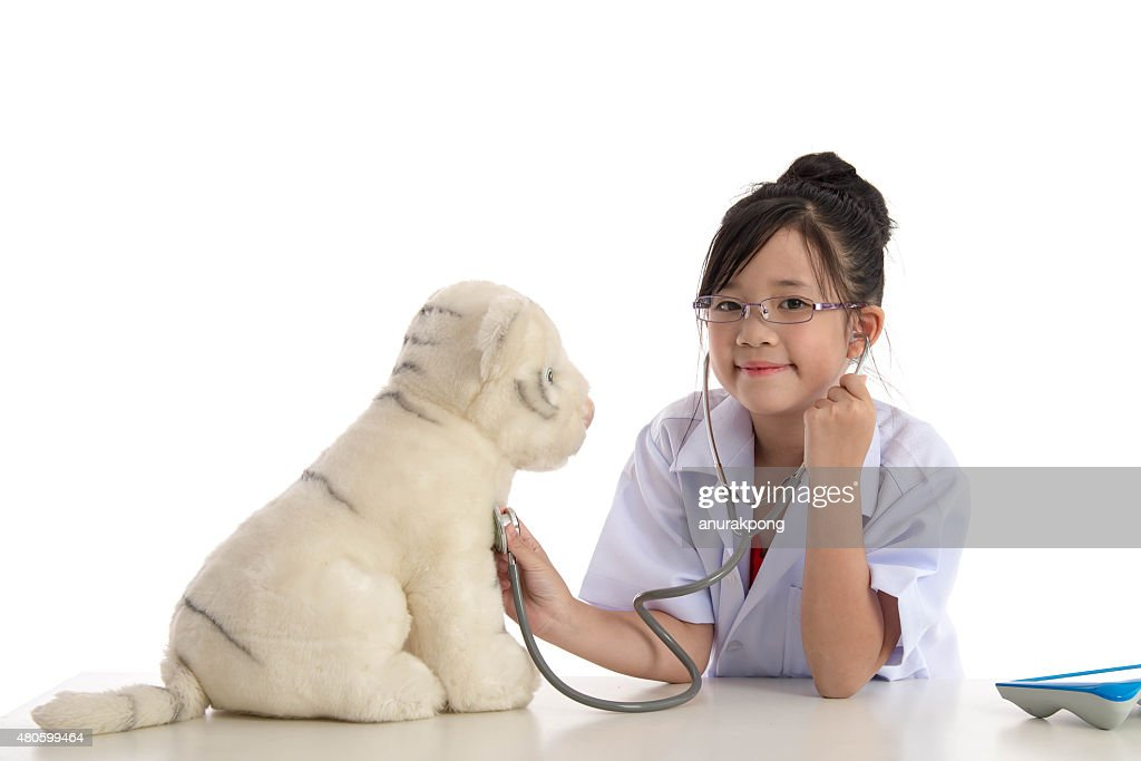 Little asian girl playing a doctor : Stock Photo