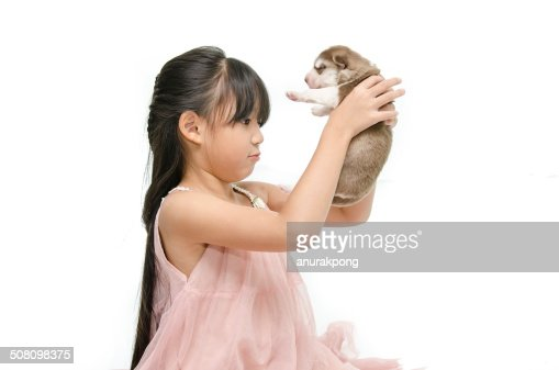 Little Asian Girl With Puppy Stock Photo