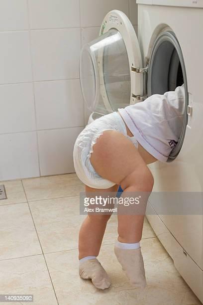 Little baby boy inside washing machine