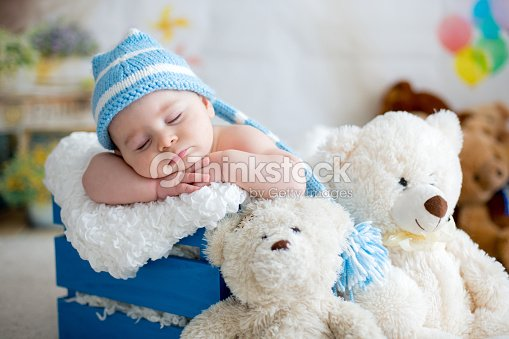e4297a269 Little Baby Boy With Knitted Hat Sleeping With Cute Teddy Bear Stock ...