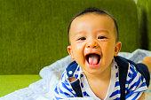 portrait of adorable curious smile baby boy close upLittle baby boy,portrait of adorable curious smile baby boy close up in black and white